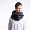 Winter scarf . A photo of a model wearing the vegan winter scaf in Charcoal.