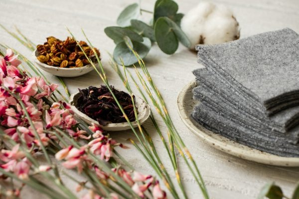 Reusable makeup remover pads in grey - a photo of zero-waste, handmade cleaning wipes made out of organic cotton