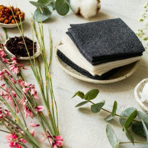 Reusable makeup remover pads in black and white - a photo of zero-waste, handmade cleaning wipes made out of organic cotton