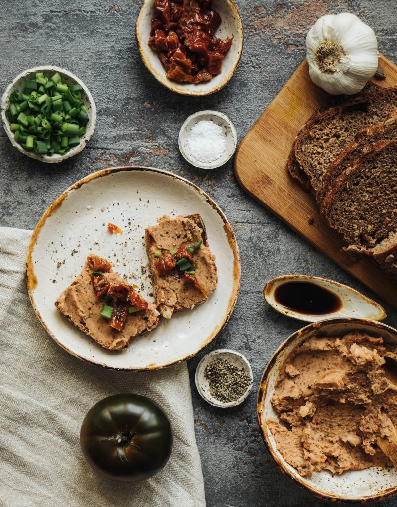 dried tomato bean spread, vegan recipes, on bread, tasty meal ideas, vegan bread