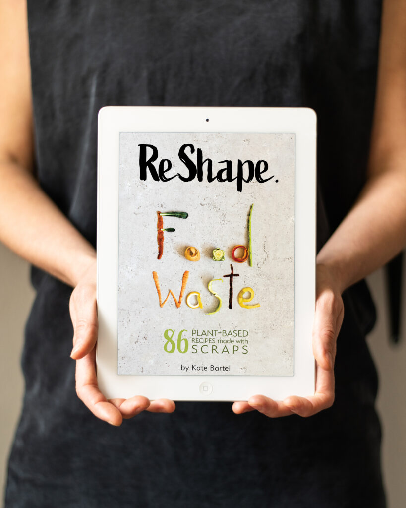 ReShape. Food Waste by Kate Bartel . A photo of a tablet with the cover of the vegan and zero-waste cookbook.