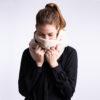 Winter scarf . A photo of a model wearing the vegan winter scaf in Creamy Beige