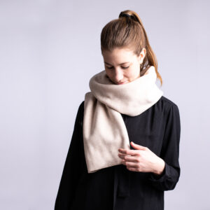 Winter scarf . A photo of a model wearing the vegan winter scaf in Creamy Beige