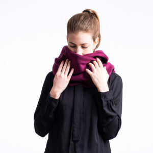 Winter scarf . A photo of a model wearing the vegan winter scaf in Mulberry Purple.