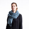 Winter scarf . A photo of a model wearing the vegan winter scaf in turquoise